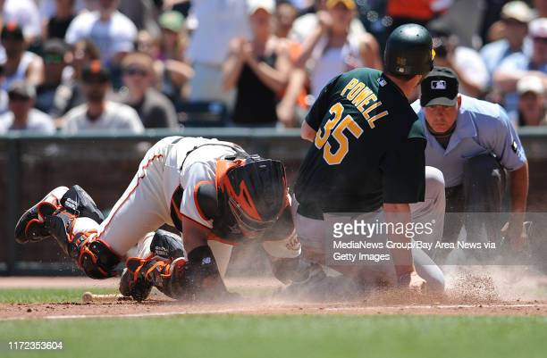 San Francisco Giants catcher Bengie Molina tags out Oakland Athletics Landon Powell as he attempts to score at home plate in the fourth inning on...
