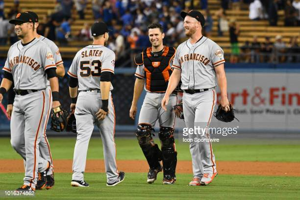 San Francisco Giants catcher Buster Posey and San Francisco Giants pitcher Will Smith are all smiles after their win during a MLB game between the...