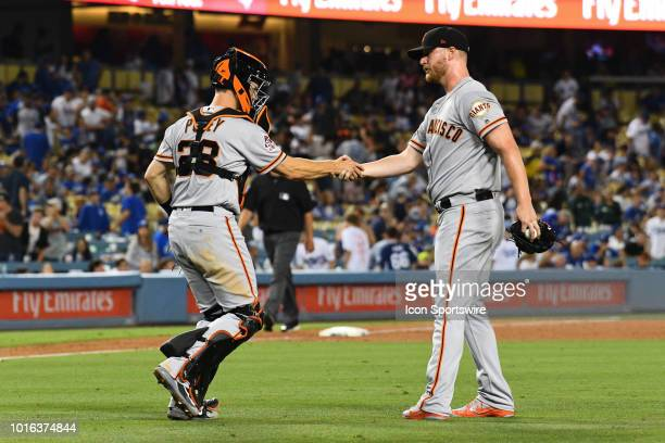 San Francisco Giants catcher Buster Posey shakes San Francisco Giants pitcher Will Smith hand after their win during a MLB game between the San...