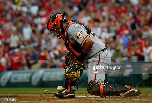 San Francisco Giants catcher Hector Sanchez bobbled the ball as Washington Nationals' Ian Desmond scored on the play during the 2nd inning at...