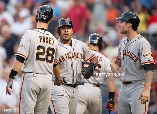 San Francisco Giants catcher Hector Sanchez is greeted at home plate by catcher Buster Posey after hitting the gamewinning threerun home run off...