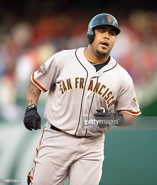 San Francisco Giants catcher Hector Sanchez rounds the bases after hitting the gamewinning threerun home run off Washington Nationals relief pitcher...