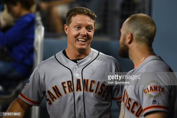 San Francisco Giants catcher Nick Hundley celebrates with San Francisco Giants third baseman Evan Longoria after his game winning hit during a MLB...