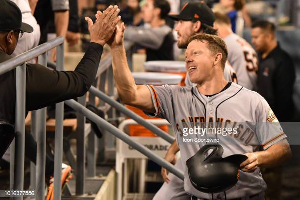 San Francisco Giants catcher Nick Hundley gets a high five after he scored a run in the 9th inning during a MLB game between the San Francisco Giants...
