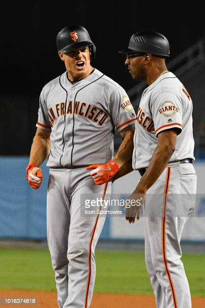 San Francisco Giants catcher Nick Hundley reacts to his go ahead base hit in the ninth inning during a MLB game between the San Francisco Giants and...