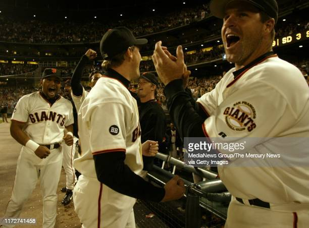 San Francisco Giants celebrate as they watched the second to last out of the Dodgers/Diamondback game following their win against the San Diego...