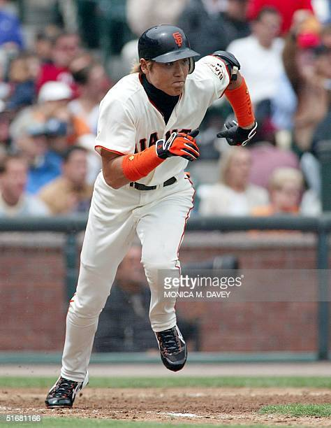 San Francisco Giants' center fielder Tsuyoshi Shinjo runs up the first base line after hitting a single against New York Mets' starting pitcher Mike...