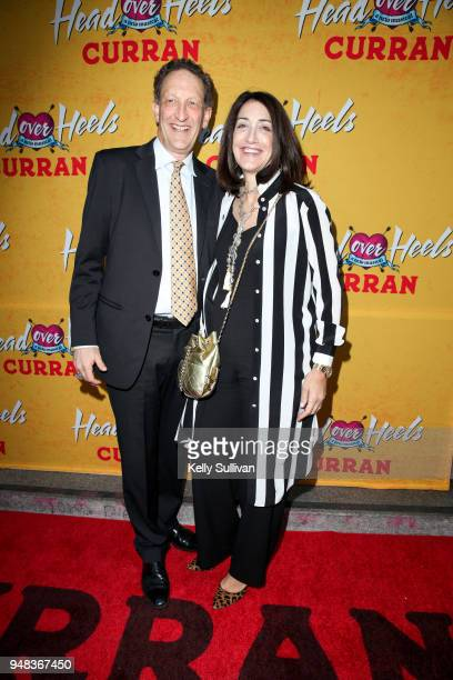 San Francisco Giants CEO Larry Baer poses for photos with his wife Pamela on the red carpet for the PreBroadway Opening Engagement Of Head Over Heels...