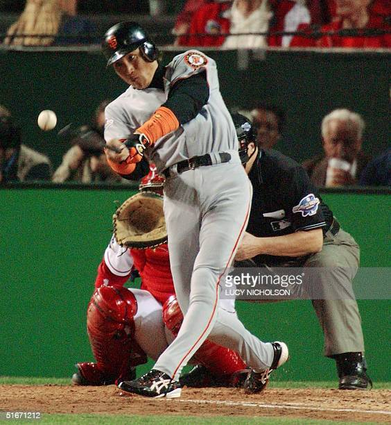 San Francisco Giants designated hitter Tsuyoshi Shinjo makes a base hit against the Anaheim Angels during Game One of the World Series in Anaheim CA...