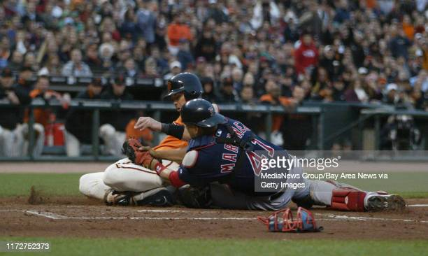San Francisco Giants' Eli Whiteside is tagged out a home by Boston Red Sox's catcher Victor Martinez in the second inning of their MLB baseball game...
