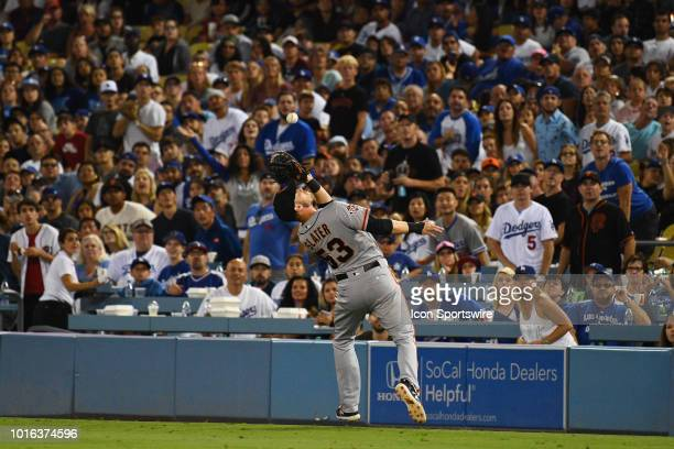 San Francisco Giants first baseman Austin Slater makes a nice catch off Los Angeles Dodgers right fielder Yasiel Puig hit during a MLB game between...