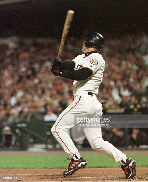 San Francisco Giants Jeff Kent watches his ball go deep into right centerfield for an RBI double during the first inning against the Arizona...