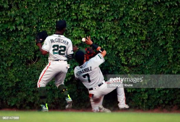 San Francisco Giants left fielder Gorkys Hernandez and San Francisco Giants center fielder Andrew McCutchen are unable to catch an RBI double by...