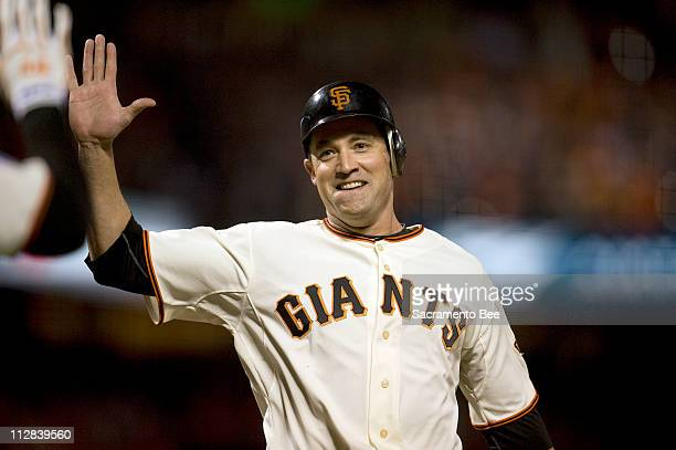 San Francisco Giants left fielder Pat Burrell scores on a base hit by Aubrey Huff during Game 1 of the World Series against the Texas Rangers at ATT...