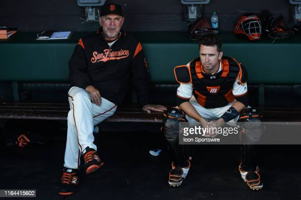 San Francisco Giants manager Bruce Bochy and catcher Buster Posey before the Major League Baseball game between the Arizona Diamondbacks and the San...