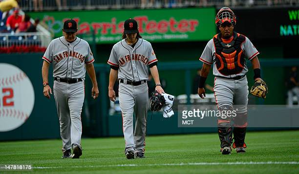 San Francisco Giants manager Bruce Bochy starter Tim Lincecum and catcher Hector Sanchez walk off the field during a MLB game against the Washington...