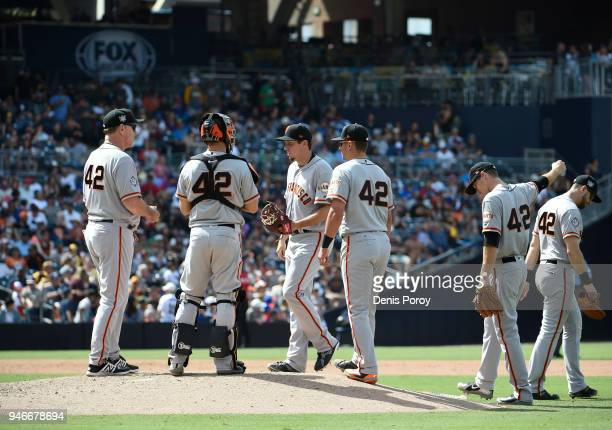 San Francisco Giants manager Bruce Bochy waits as Derek Law comes into the game during the sixth inning of a baseball game against the San Diego...