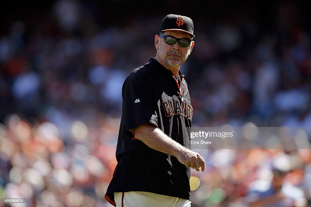 San Francisco Giants manager Bruce Bochy walks back to the dugout during their game against the Milwaukee Brewers at AT&T Park on August 31, 2014 in San Francisco, California.