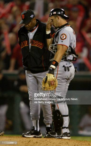 San Francisco Giants manager Dusty Baker and catcher Benito Santiago wait on the mound for Tim Worrell in the seventh inning after Russ Ortiz, Felix...
