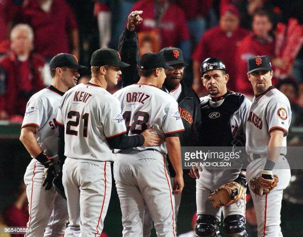 San Francisco Giants manager Dusty Baker signals for a new pitcher as he relieves Russ Ortiz in the seventh inning of Game 6 of the World Series in...