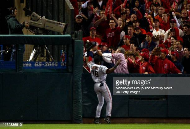 San Francisco Giants outfielder Kenny Lofton can't quite get to this 3-run-home run hit by Angels first baseman Scott Spiezio in the seventh inning....