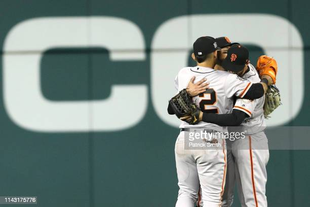 San Francisco Giants outfielders celebrate after defeating the Washington Nationals at Nationals Park on April 16 2019 in Washington DC All uniformed...