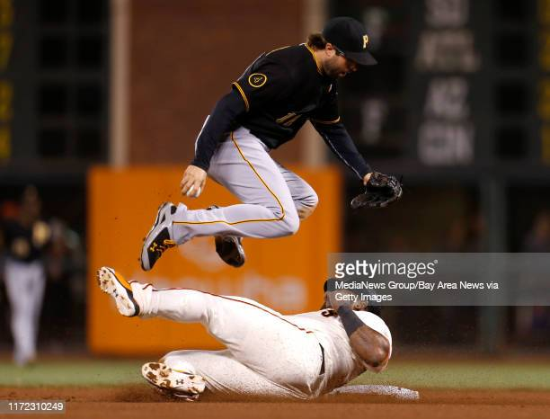 San Francisco Giants' Pablo Sandoval breaks up a potential double play after being thrown out at second base against Pittsburgh Pirates' Neil Walker...