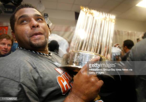 San Francisco Giants Pablo Sandoval celebrates with the World Series trophy after they won Game 5 against the Texas Rangers 31 to win the World...