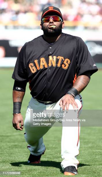 San Francisco Giants' Pablo Sandoval chews on his mouth guard while warming up prior their Spring Training Cactus League game against the Arizona...