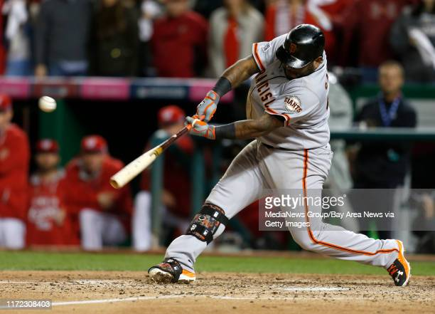 San Francisco Giants' Pablo Sandoval hits an RBI double against the Washington Nationals in the ninth inning at Nationals Park for Game 2 of their...