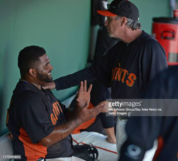 San Francisco Giants' Pablo Sandoval is all smiles as bench coach Ron Wotus comments on his base running while playing the Los Angeles Angels in the...