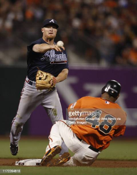 San Francisco Giants Pablo Sandoval is forced out at second base by Atlanta Braves Brooks Conrad in the seventh inning at ATT Park for Game 2 of the...