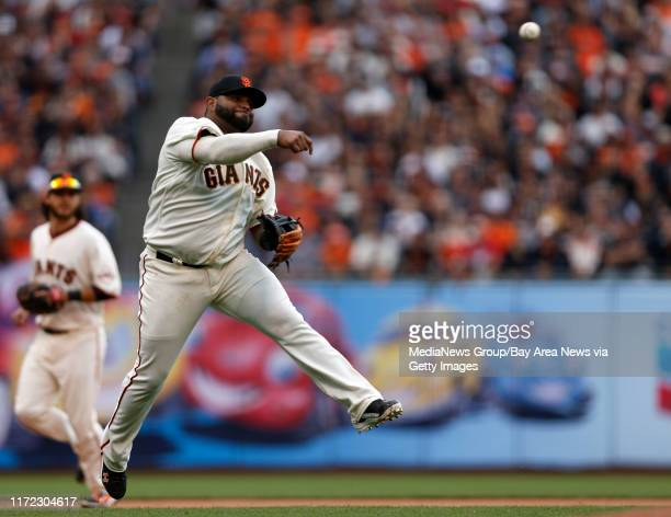 San Francisco Giants' Pablo Sandoval makes a throw to first for an out against the St Louis Cardinals in the sixth inning of Game 3 of the National...