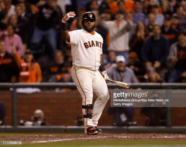 San Francisco Giants' Pablo Sandoval waves to San Francisco Giants' Joe Panik to head home on a wild pitch against the Washington Nationals in the...