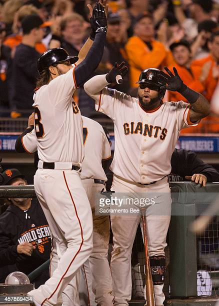 San Francisco Giants pinch hitter Michael Morse left and Pablo Sandoval celebrate scoring on Joe Panik's tworun double in the seventh inning against...
