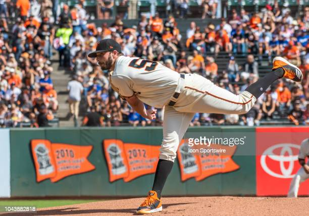 San Francisco Giants Pitcher Andrew Suarez follows through with a pitch during the game between the Los Angeles Dodgers and the San Francisco Giants...
