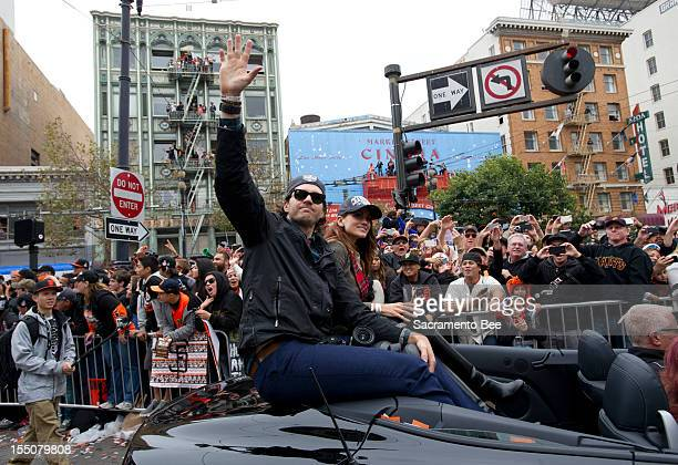 San Francisco Giants pitcher Barry Zito waves to fans during a parade to celebrate the team's 2012 World Series Championship in downtown San...