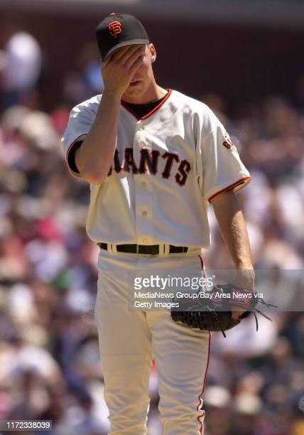 San Francisco Giants' pitcher Kurt Ainsworth, #32, wipes his face while pitching to New York Mets' Jason Phillips, #23, in the 4th inning of their...