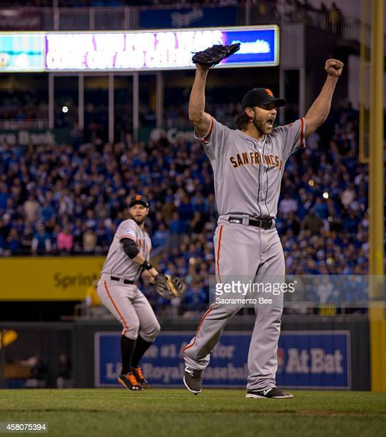 San Francisco Giants pitcher Madison Bumgarner raises his arms after the final out in the ninth inning against the Kansas City Royals in Game 7 of...