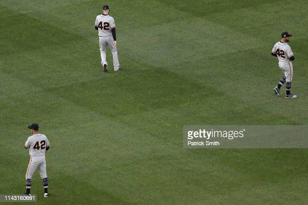 San Francisco Giants players warm up before playing against the Washington Nationals at Nationals Park on April 16 2019 in Washington DC All...