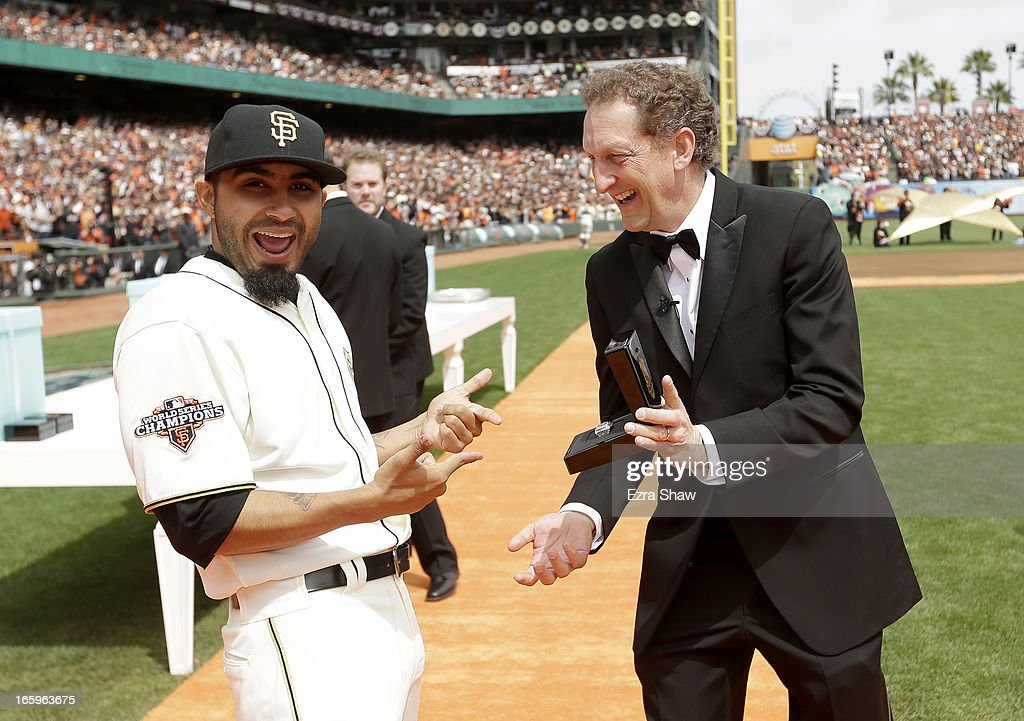 San Francisco Giants President and Chief Executive Officer Larry Baer gives Sergio Romo #54 his 2012 Championship Ring during a pregame ceremony honoring the 2012 World Series champions before their game against the St. Louis Cardinals at AT&T Park on April 7, 2013 in San Francisco, California.