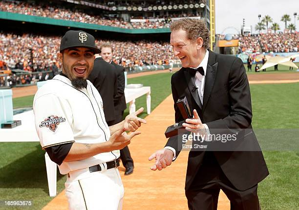 San Francisco Giants President and Chief Executive Officer Larry Baer gives Sergio Romo his 2012 Championship Ring during a pregame ceremony honoring...