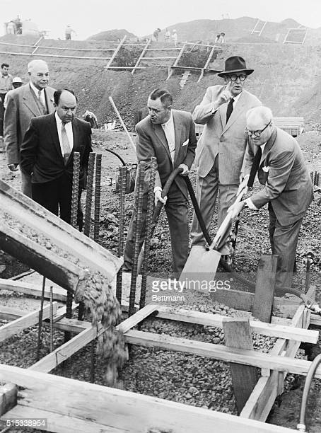 San Francisco Giants' President Horace Stoneham tamps down the first pour of concrete at new Giants ball park at Candlestick Point here 10/28 as...