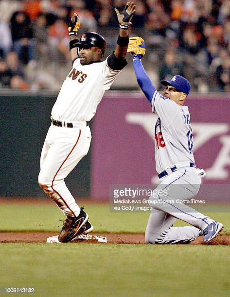 San Francisco Giants' Ray Durham and Los Angeles Dodger shortstop Ramon Martinez await the call after Durham's attempt to steal second base during...