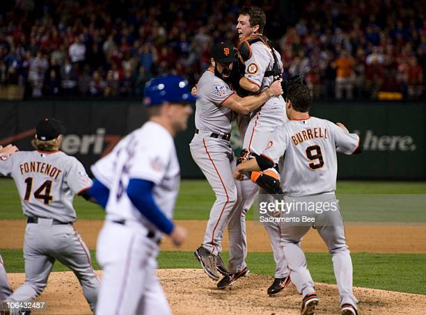 San Francisco Giants relief pitcher Brian Wilson celebrates with left fielder Pat Burrell first baseman Aubrey Huff and catcher Buster Posey after...