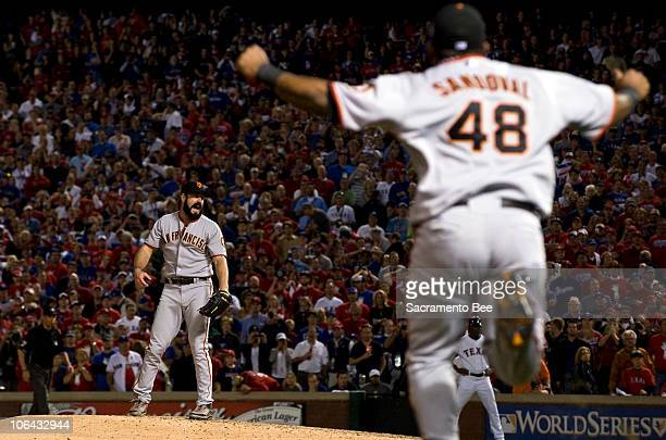 San Francisco Giants relief pitcher Brian Wilson celebrates with third baseman Pablo Sandoval after winning the World Series against the Texas...