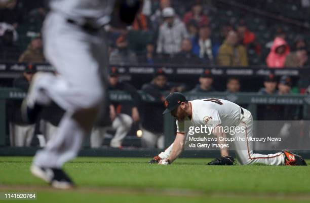 San Francisco Giants relief pitcher Sam Dyson fields a bunt by San Diego Padres' Manuel Margot in the eighth inning of their MLB game at Oracle Park...