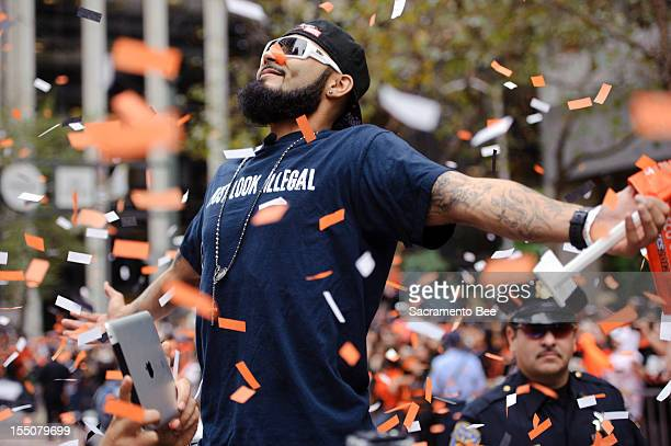 San Francisco Giants relief pitcher Sergio Romo enjoys the ride during a parade to celebrate the team's 2012 World Series Championship in downtown...