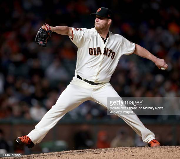 San Francisco Giants relief pitcher Will Smith throws against the Los Angeles Dodgers in the ninth inning of their MLB game at Oracle Park in San...