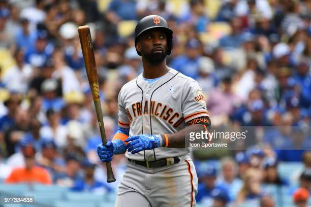 San Francisco Giants right fielder Andrew McCutchen walks back to the dugout after striking out during a MLB game on Father's Day between the San...